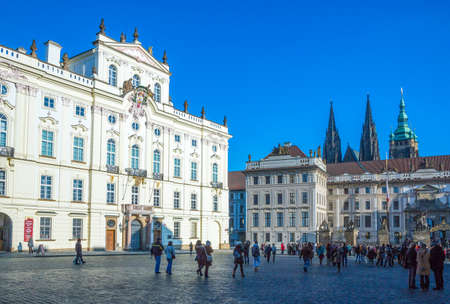 Prague, Czech Republic - December 1, 2012: Castle district,  local people an tourists in front of the Archbishop palace Editöryel
