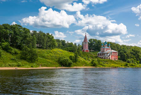 Russia, Rybinsk, a red Othodox church in the outskirts of the city, seen from the Volga river Stock Photo