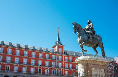 Spain, Madrid, the ancient palaces of Plaza Mayor with the equestrian statue of King Philip III