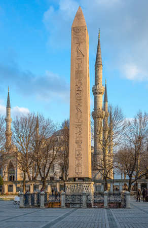 Istambul , Turkey - February 20, 2013: The Obelisk of the Hippodrome square and in the background the Blue Mosque