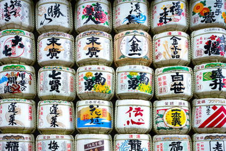 Tokyo, Japan - June 7, 2017: Exhibition of traditional Sake barrels given as ghifts to the Meiji Sanctuary (the scriptures in Japanese indicate the content of barrels and religious verses)