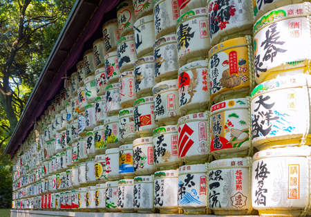 Tokyo, Japan - April 21, 2018:  Exhibition of traditional Sake barrels given as ghifts to the Meiji  Juku Sanctuary (the scriptures in Japanese indicate the content of barrels and religious verses)