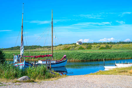 Denmark, Jutland peninsula, Nymingab district, fishermen and leisure boats in the outflow of the Ringkobing fjord Stock Photo