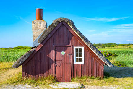 Denmark, Jutland peninsula, Nymingab district, ancient fishermen house in the outflow of the Ringkobing fjord