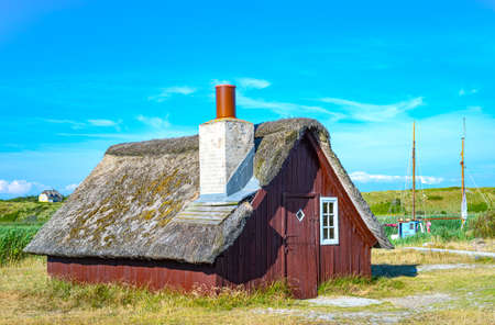 Denmark, Jutland peninsula, Nymingab district, ancient fishermen house in the outflow of the Ringkobing fjord Stock Photo - 127646517