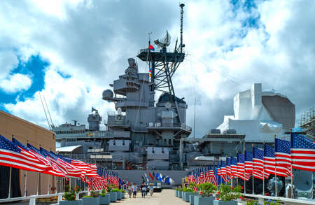 Honolulu, Awaii - May 3, 2019: Pearl Harbor, America flags on the road leading to  the Missoury Battleship