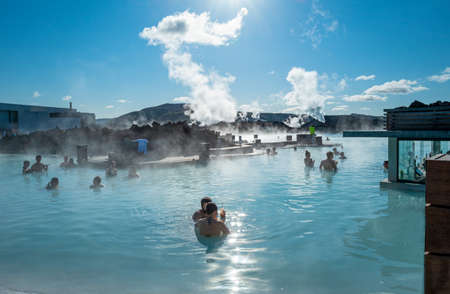 Grindavic, Iceland - May 31, 2019:  Blue Lagoon geothermal hot spring Resort, people in the pool with bar