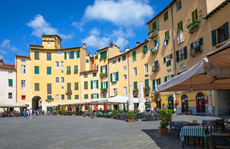 Lucca, Italy - June 5, 2018: The architectures arranged in a hemicycle of the Anfiteatro square
