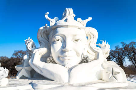 Harbin, China - January 2015: Snow sculpture of a girl in the 27th China Harbin Sun Island International Snow Sculpture Art Expo. Located in Harbin City, Heilongjiang, China. Editorial