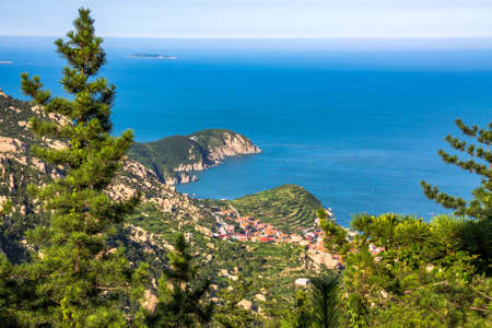 View of a fishing village in Laoshan Mountain, seen from Ba Shui He trails in the Summer, Qingdao, China