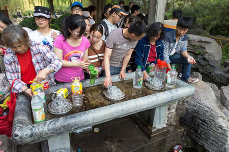 April 2015 - Jinan, China - local people taking water from the springs in the famous Baotu Quan in Jinan, also called the Best Spring in the World.
