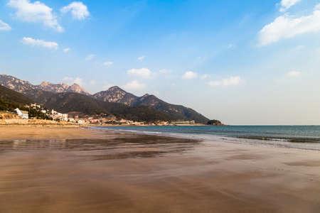 Liu Qinghe beach in late winter afternoon. Qingdao, close to Laoshan Scenic Area 写真素材