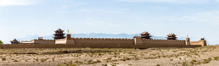 View of Jiayuguan Fort with snow capped mountains on the background, Gansu, China. Known as