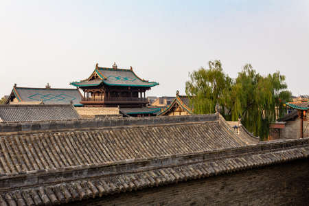 Decorated tiles roofs in the ancient city of Pingyao, Shanxi province, China. Known as one of the best preserved historical villages of China.