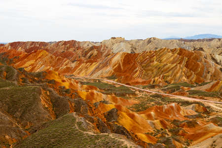 Danxia Feng, or Colored Rainbow Mountains, in Zhangye, Gansu, China. Here the view from the Colorful clouds observation deck