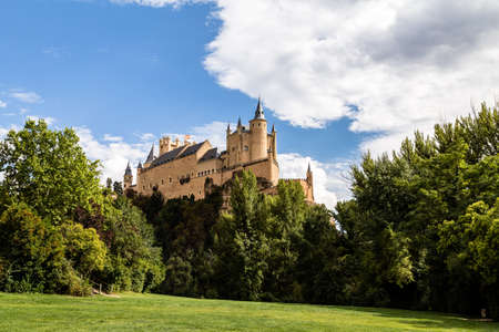 The famous view of the Alcazar of Segovia in sunny summer day from the view point of the Pradera de San Marcos, Segovia, Castilla y Leon, Spain