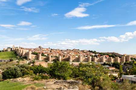 Avila from the Mirador of Cuatro Postes, Spain, with its famous medieval town walls. Called the Town of Stones and Saints