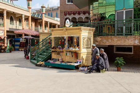 Aug 2017, Kashgar, Xinjinag, China: local Uighur people in the streets of Kashgar Ancient Town. Kashgar is a popular tourist spot along the Silk Road and one of the westernmost cities of China
