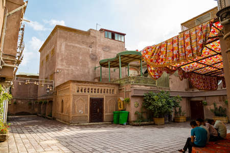 Aug 2017, Kashgar, Xinjinag, China: small square in the streets of Kashgar Ancient Town. Kashgar is a popular tourist spot along the Silk Road and one of the westernmost cities of China Editorial