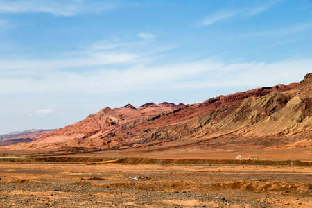 Flaming mountains, Turpan, Xinjiang, China: these intense red arid mountains appear in the Chinese epic? Journey to the west ?. Turpan is an ancient oasis on the Silk Road
