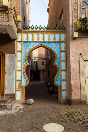 Kashgar, Xinjinag, China: arabic style decorated archway in the streets of Kashgar Ancient Town. Kashgar is a popular tourist spot along the Silk Road and one of the westernmost cities of China