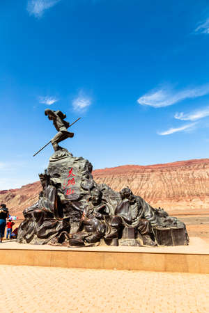 Aug 2017, Flaming Mountains, Xinjiang, China: tourists near a statue of the Chinese epic? Journey to the west? when the monkey king and his companions reach the flaming mountains Editorial