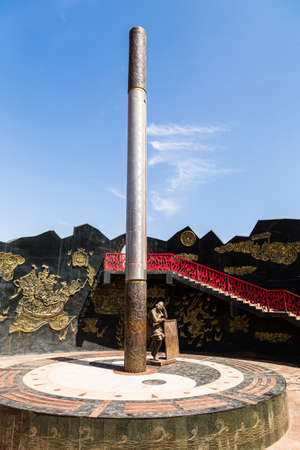 Aug 2017, Flaming Mountains, Xinjiang, China: giant thermometer and monkey king statue at the flaming mountains site in the Turpan basin. Max recorded temperature here has been 66.8 degrees Editorial