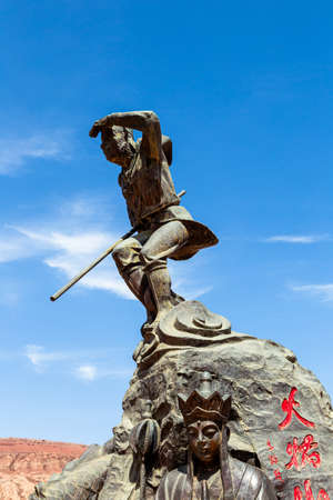 Aug 2017, Flaming Mountains, Xinjiang, China: statue from the scene of the Chinese epic? Journey to the west? when the monkey king and his companions reach the flaming mountains Imagens - 127627274