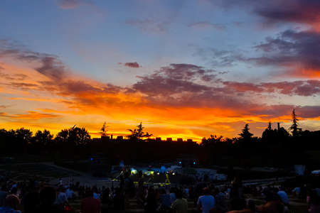 15th May 2019? Madrid, Spain: people watching the sunset behind the stage in Parque Tierno Galvan before the fireworks show during the San Isidro Festival of Madrid