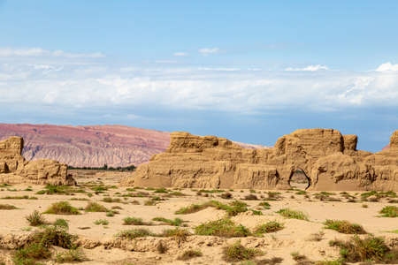 Ruins of Gaochang, Turpan, China. Dating more than 2000 years, Gaochang and Jiaohe are the oldest and largest ruins in Xinjiang. The Flaming mountains are visible in the background Imagens