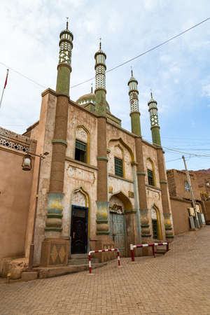 Tuyoq village (Tuyuk): the mosque of this traditional uighur village set in a lush valley cutting through the flaming mountains near Turpan, Xinjiang, China.