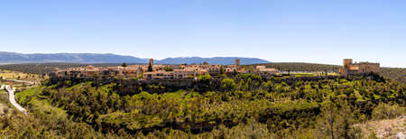 Pedraza, Castilla Y Leon, Spain: panorama of Pedraza village from Mirador the Tungueras, with the Sierra de Guadarrama behind. Pedraza is one of the best preserved medieval villages of Spain