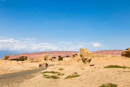 Ruins of Gaochang, Turpan, China. Dating more than 2000 years, Gaochang and Jiaohe are the oldest and largest ruins in Xinjiang. The Flaming mountains are visible in the background 写真素材
