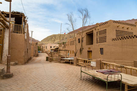 Tuyoq village (Tuyuk): one of the streets of this traditional uighur village set in a lush valley cutting through the flaming mountains near Turpan, Xinjiang, China