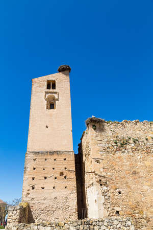 Pedraza, Castilla Y Leon, Spain: ruins of Iglesia de Santa Maria with giant bird's nests on top. Pedraza is one of the best preserved medieval villages of Spain, not far from Segovia Imagens - 123843213