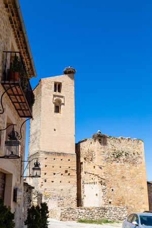 Pedraza, Castilla Y Leon, Spain: ruins of Iglesia de Santa Maria with giant bird's nests on top. Pedraza is one of the best preserved medieval villages of Spain, not far from Segovia Stock Photo