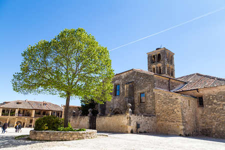 May 2019, Pedraza, Castilla Y Leon, Spain: Iglesia de San Juan Bautista. Pedraza is one of the best preserved medieval villages of Spain, not far from Segovia Editorial