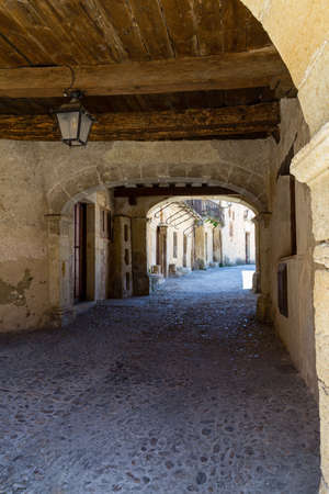 may 2019, Pedraza, Castilla Y Leon, Spain: covered alley behind Plaza Mayor. Pedraza is one of the best preserved medieval villages of Spain, not far from Segovia