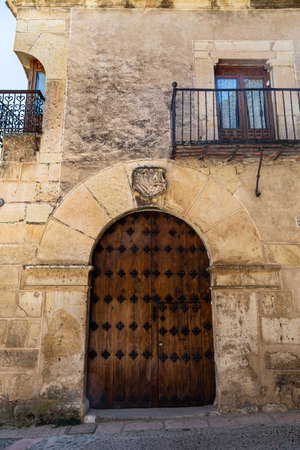 may 2017, Pedraza, Castilla Y Leon, Spain: reinforced iron doorway with heraldic crest above. Pedraza is one of the best preserved medieval villages of Spain, not far from Segovia