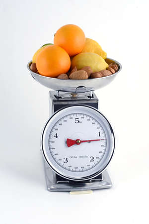 weighs: oranges with lemons and almonds on balance