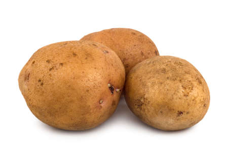 Three potatoes isolated on a white background photo