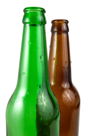 Two beer bottle covered with water drops, isolated on white photo