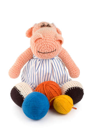 handwork: Soft toy hippopotamus and balls of thread handwork isolated on white background Stock Photo
