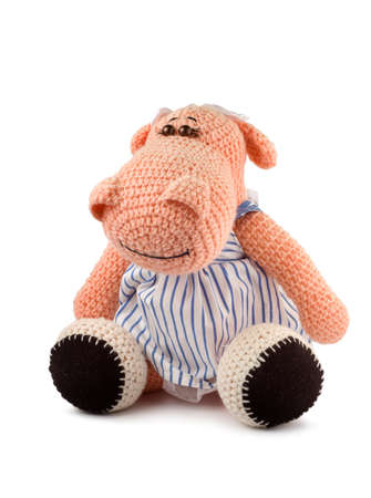 handwork: Soft toy hippopotamus handwork isolated on white background