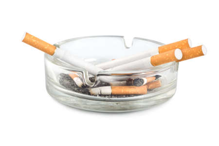 ashtray: Cigarettes in an ashtray isolated on white background