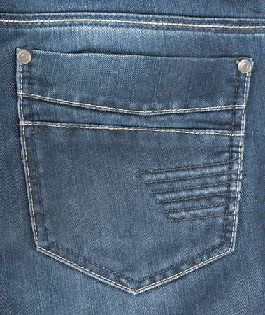 The background of the back pocket of blue jeans photo