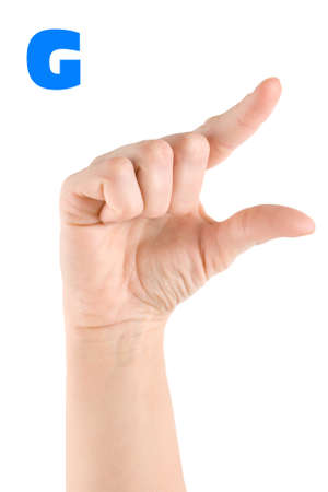 Finger Spelling the Alphabet in American Sign Language (ASL). The Letter G . photo