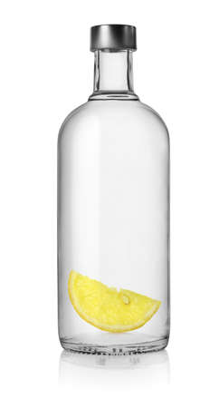 vodka bottle: Vodka and lemon Stock Photo