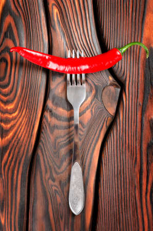 red chilly: Red chili pepper and fork