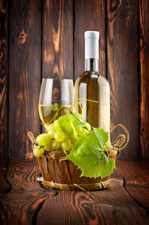 White wine with grapes photo